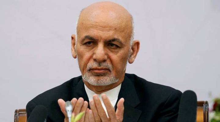 Afghan President Ashraf Ghani prays during a peace and security cooperation conference in Kabul